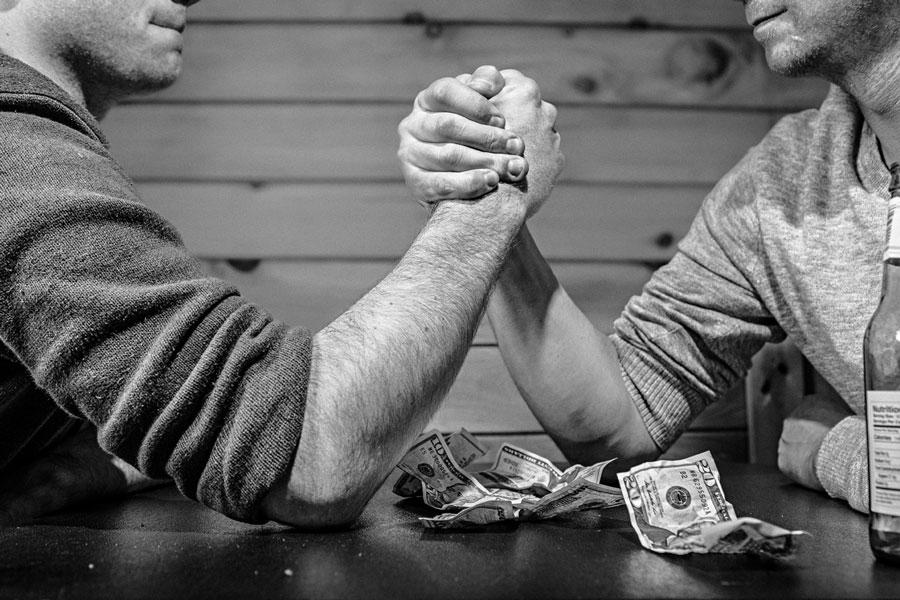 2 men arm wrestling