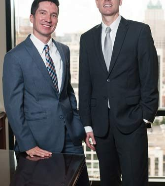 Shawn T. Jewell  & Eric R. Elms | Fisher Rushmer, P.A.